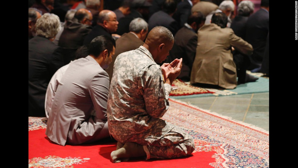 A U.S. Army soldier prays at the Washington National Cathedral, which was hosting its first Muslim prayer service on Friday, November 14.