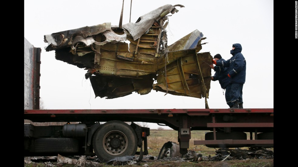 "Workers in Hrabove, Ukraine, <a href=""http://www.cnn.com/2014/11/16/world/europe/netherlands-ukraine-mh17-wreckage/index.html"">begin recovering wreckage</a> from Malaysia Airlines Flight 17 on Sunday, November 16. The passenger jet carrying 298 people was shot down in July over a rural area of eastern Ukraine controlled by pro-Russian separatists. Because the crash site was unsecured, international investigators struggled to reach the area amid fighting between the rebels and Ukrainian government forces."