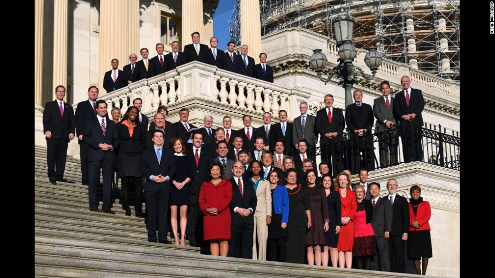 Newly elected members of the U.S. House of Representatives pose for a group photo on Capitol Hill on Tuesday, November 18. They will take office in January.