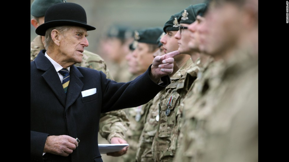 Britain's Prince Philip visits the armored regiment of the Queen's Royal Hussars in Paderborn, Germany, on Wednesday, November 19. He was awarding soldiers who just returned from Afghanistan.