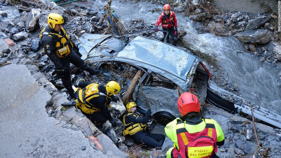 Rescuers look for a missing person in Serra Ricco, Italy, after a wave of storms and torrential rain hit northern Italy on Sunday, November 16.