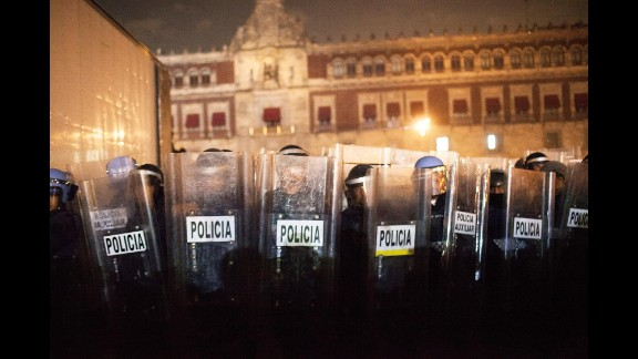 Police guard the National Palace in Mexico City as protesters and police clash on November 20.