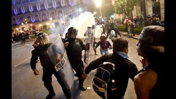 Demonstrators clash with riot police on November 20.