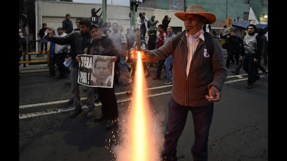 A protester lights a firework as demonstrators march on November 20.
