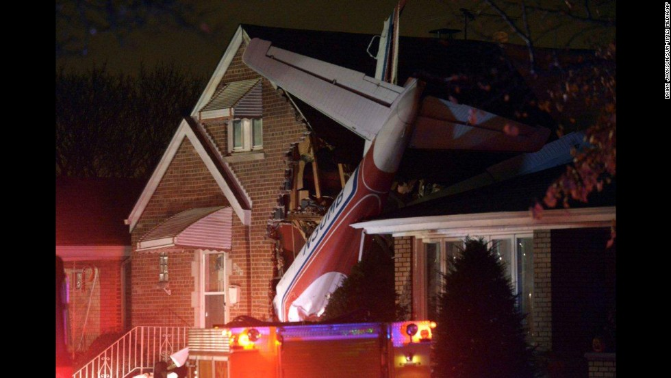 A twin-engine cargo plane is seen after crashing into a Chicago house shortly after taking off from Midway International Airport on Tuesday, November 18. The pilot, who reported engine problems prior to the crash, was killed. The plane narrowly missed a couple sleeping in the house.