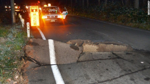 A road buckled after a strong earthquake hit central Japan.