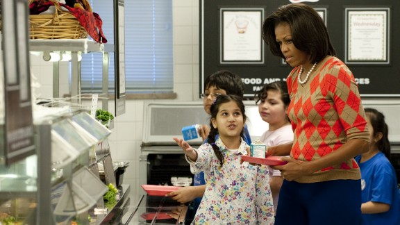 Then-first lady Michelle Obama in a school lunch line in the cafeteria at a Virginia elementary school in 2012.