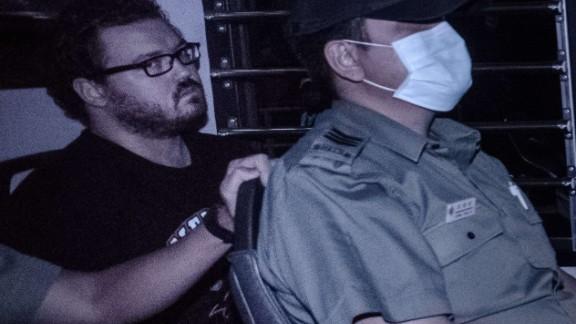 British banker Rurik Jutting seen in a police van November 10, 2014.