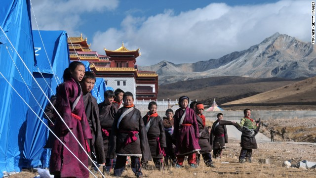 Tibetan youngsters gather outside makeshift tents at a relief center in Kangding on November 23, near where the earthquake struck.