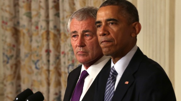 WASHINGTON, DC - NOVEMBER 24:  U.S. President Barack Obama (R) speaks as Secretary of Defense Chuck Hagel looks on during a press conference announcing Hagel
