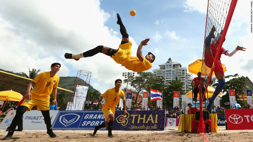 Thailand's Phakping Dejaroen plays a shot during a sepak takraw match Sunday, November 23, at the Asian Beach Games in Phuket, Thailand. Thailand defeated Indonesia in the men's regu final.