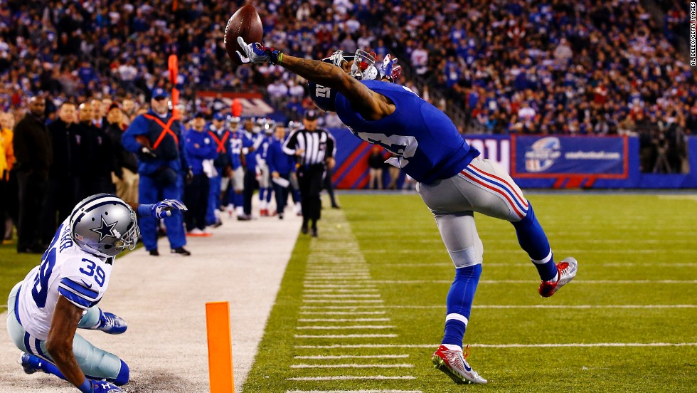 New York Giants wide receiver Odell Beckham Jr. makes a spectacular one-handed touchdown grab Sunday, November 23, in East Rutherford, New Jersey. The highlight gave the Giants an early first-half lead against Dallas, but their NFC East rivals came back to win 31-28.