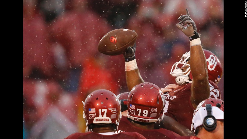 Oklahoma running back Samaje Perine is lifted by his teammates after he broke the NCAA single-game rushing record Saturday, November 22, in Norman, Oklahoma. The freshman had 427 yards against Kansas, breaking the record that Wisconsin's Melvin Gordon had set just one week earlier.