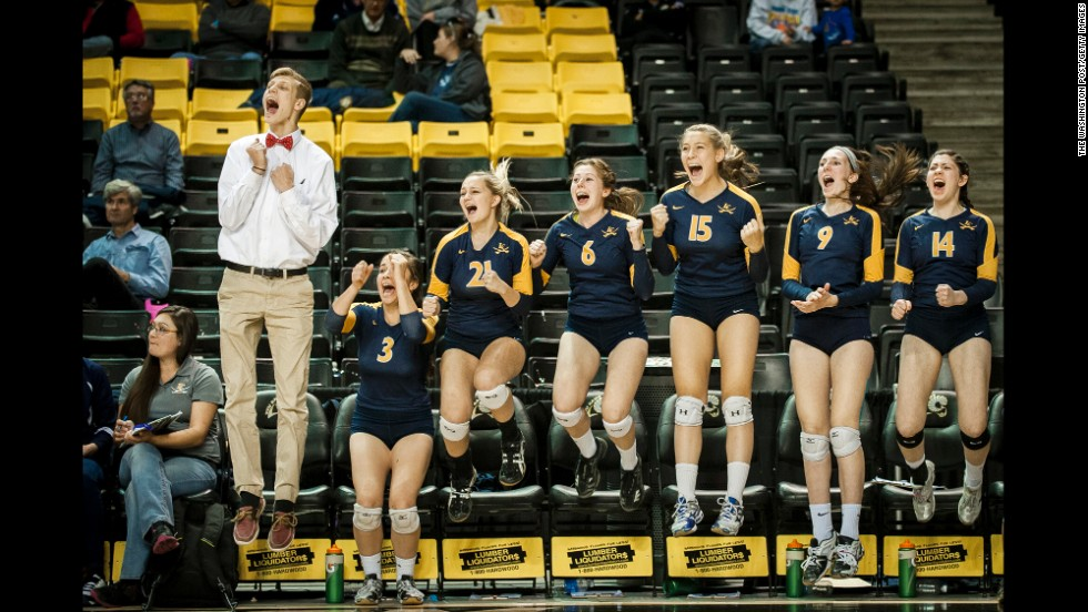 Volleyball players from Loudoun County High School celebrate match point as they defeated James Woods High School to win the Virginia 4A state championship Saturday, November 22, in Richmond, Virginia.