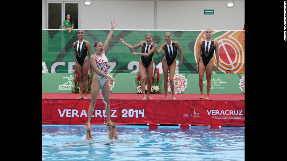 Mexico's synchronized swimming team performs a medley by the Beatles on the way to winning gold Wednesday, November 19, at the Central American and Caribbean Games in Veracruz, Mexico.