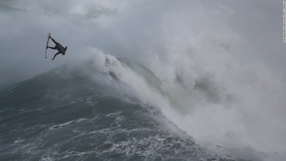 Surfer Hugo Vau drops in on a large wave Thursday, November 20, at Praia do Norte in Portugal.