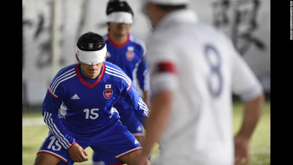 Japanese soccer player Roberto Izumi Sasaki, left, takes on France during a five-a-side match Wednesday, November 19, at the Blind Football World Championships. Japan qualified for the next round after a 1-1 draw.