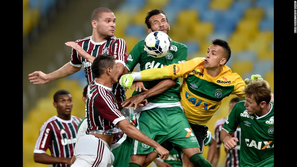 Players from Fluminense and Chapecoense struggle for the ball during a Brazilian league soccer match played Thursday, November 20, in Rio de Janeiro. Chapecoense won 4-1.
