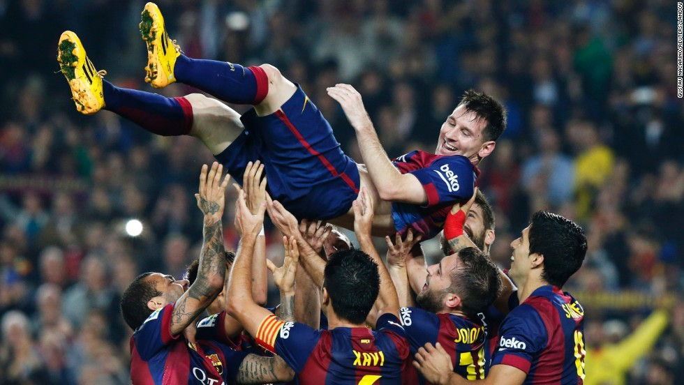 Barcelona players lift Lionel Messi on Saturday, November 22, after he broke the record for career goals in La Liga, the top tier in Spanish soccer. Messi has scored 253 league goals, with his latest three coming in Barcelona's 5-1 home victory over Sevilla.