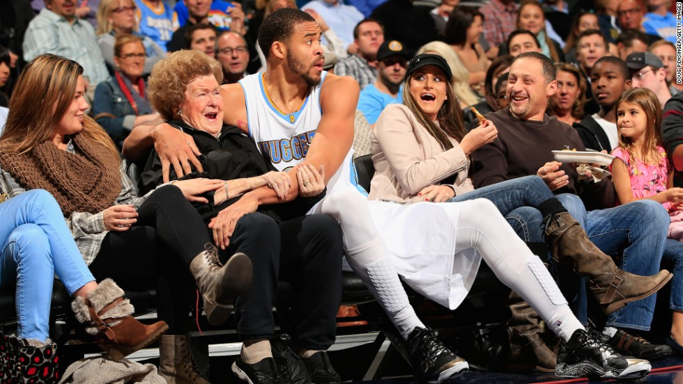 "Denver Nuggets center JaVale McGee hugs a fan after he dove into the front row for a loose ball Friday, November 21, in Denver. He also <a href=""https://www.youtube.com/watch?v=2NEqYqgpszk"" target=""_blank"">gave the woman a kiss.</a>"
