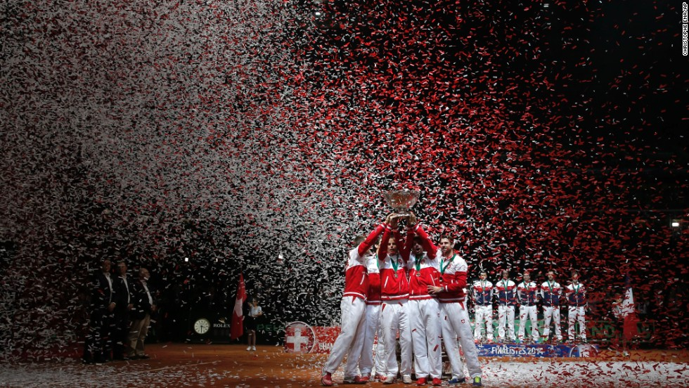 Swiss tennis players celebrate after they defeated France in the Davis Cup final Sunday, November 23, in Lille, France. It was the first Davis Cup the country has ever won.