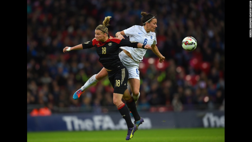 Germany's Alexandra Popp, left, and England's Lucy Bronze compete for the ball during an international friendly match in London on Sunday, November 23.