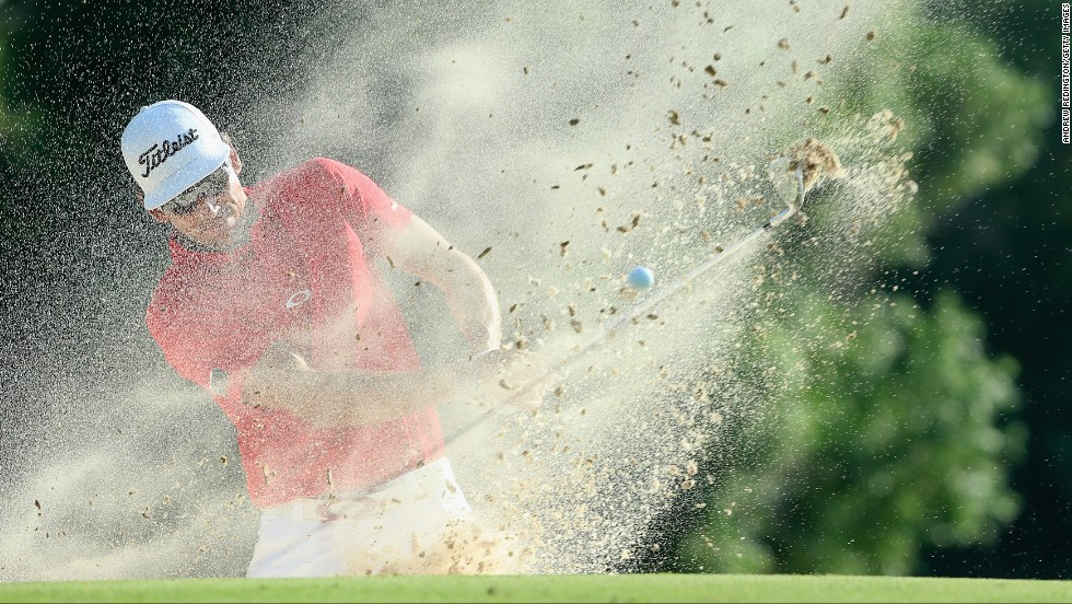 Rafa Cabrera-Bello blasts a ball out of the bunker on Sunday, November 23, during the final round of the DP World Tour Championship in Dubai, United Arab Emirates.