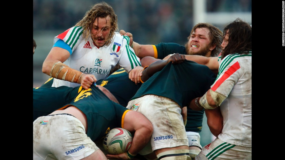 Rugby players from Italy and South Africa fight for the ball during a scrum Saturday, November 22, in Padua, Italy. South Africa won the match 22-6.