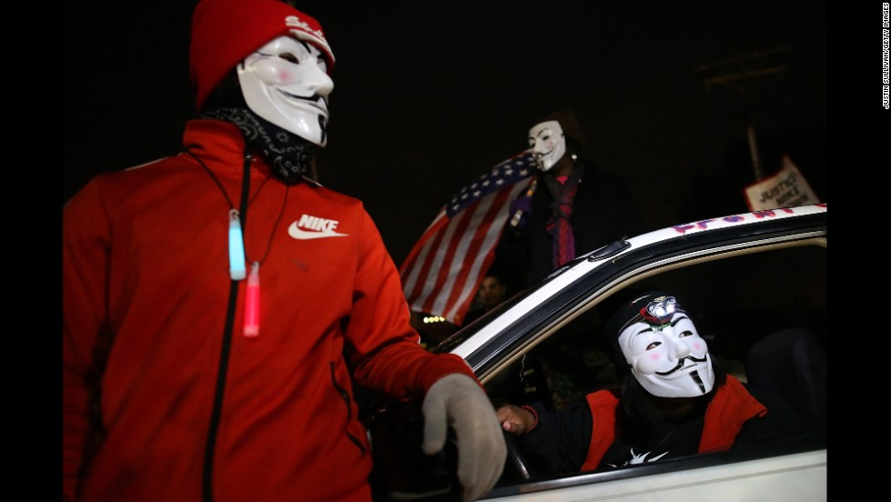 Demonstrators block traffic during a protest in front of the Ferguson Police Department on November 24.