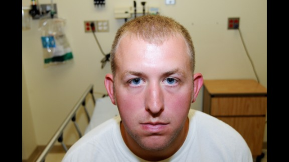 Officials released never-before-seen photos of Ferguson, Missouri, police officer Darren Wilson after it was announced Monday, November 24, that a grand jury had chosen not to indict Wilson for the shooting death of Michael Brown. These photos were taken on the day of Wilson