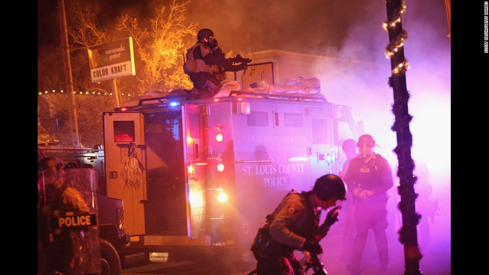 Police confront protesters in Ferguson on November 24.