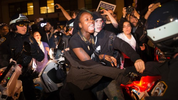 A protester in New York scuffles with police during a march toward Times Square on November 24.