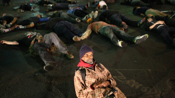 Protesters in Los Angeles lie down in a major intersection to block traffic on November 24.