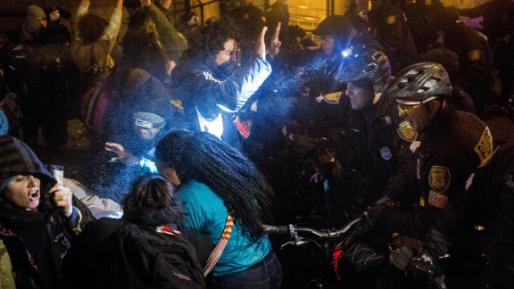 Seattle police attempt to push back protesters with pepper spray and flash-bang grenades on November 24.