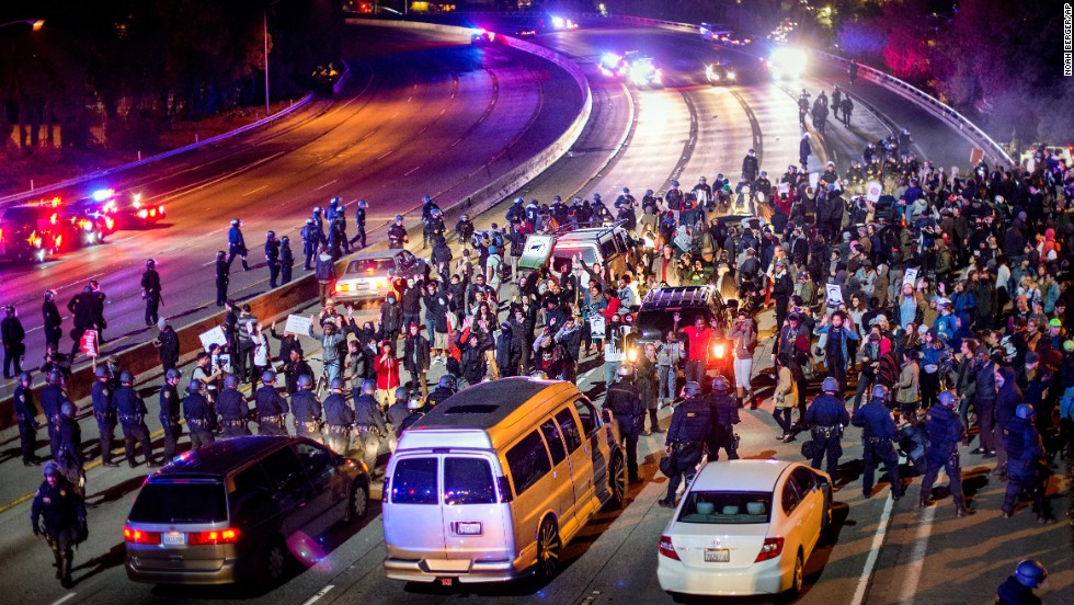 Protesters block Interstate 580 in Oakland on November 24.