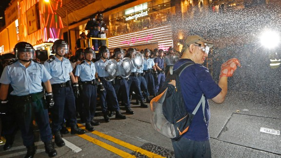 A demonstrator is sprayed with pepper spray by the police after refusing to leave the protest site on November 25.