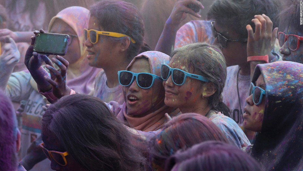 "People take a selfie during the Color Run event in Jakarta, Indonesia, on Sunday, November 23. During the race, which is billed as ""the happiest 5K on the planet,"" participants are doused with colored powder."