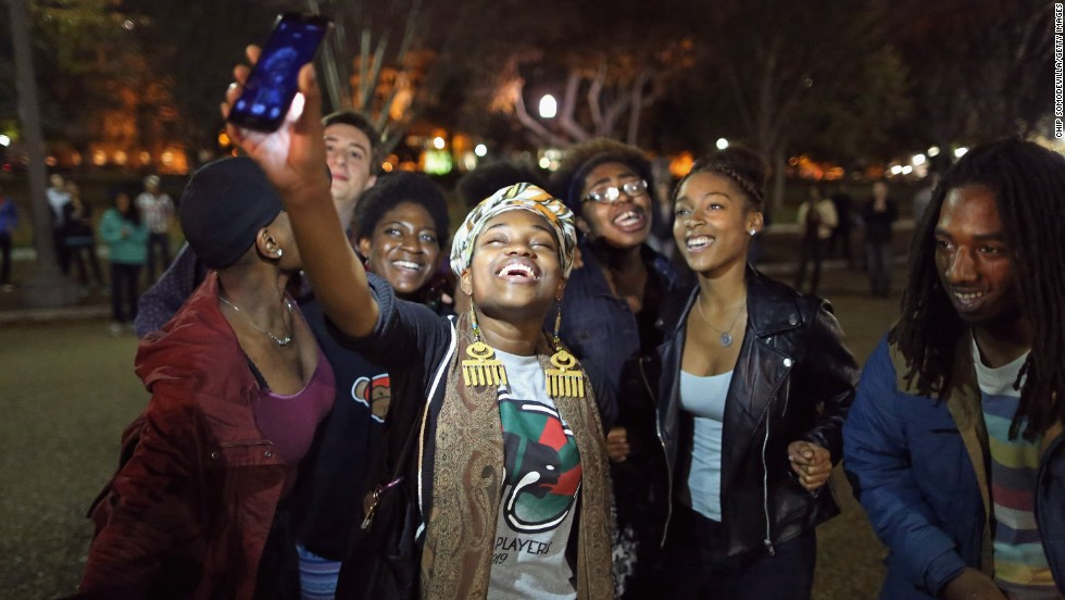 "Protesters sing, chant and dance outside the White House on Tuesday, November 25, after it was announced that Darren Wilson, a police officer in Ferguson, Missouri, would not be indicted in the shooting death of Michael Brown. The grand jury's decision not to indict Wilson <a href=""http://www.cnn.com/2014/11/25/justice/gallery/national-ferguson-protests/index.html"">prompted demonstrations across the country.</a>"
