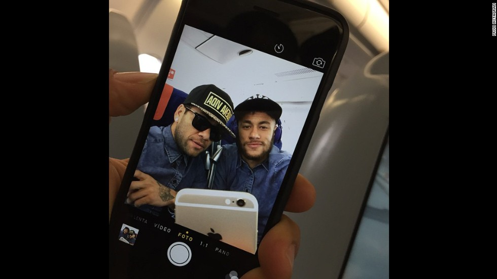 "Soccer star Neymar, right, <a href=""http://instagram.com/p/vxnNOJxtmy/?modal=true"" target=""_blank"">posted this selfie</a> of him and Barcelona teammate Dani Alves on Monday, November 24."