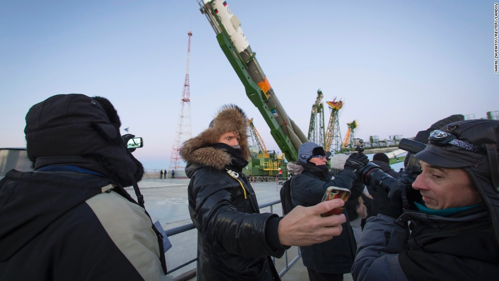 A man takes a selfie as the Soyuz TMA-15M spacecraft is lifted to its launch pad Friday, November 21, at the Baikonur Cosmodrome in Kazakhstan. The Soyuz took off a few days later, carrying three people to the International Space Station.
