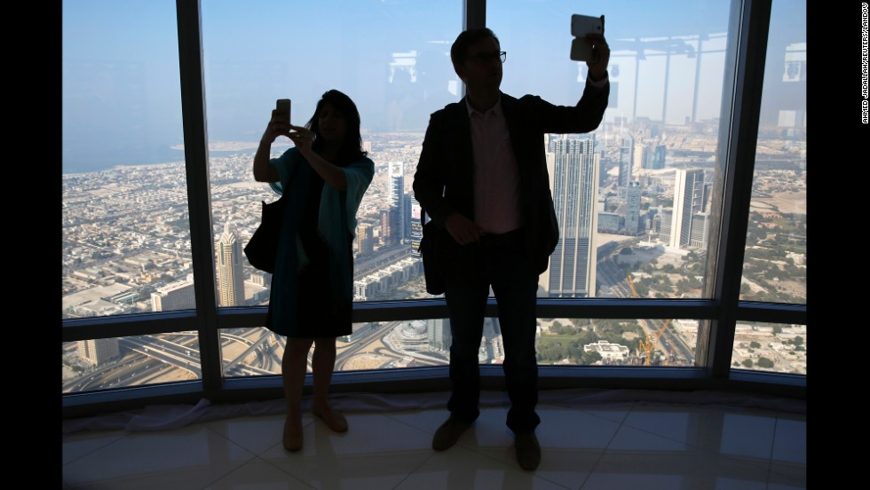 People take selfies from the Burj Khalifa, the tallest building in the world, in Dubai, United Arab Emirates, on Wednesday, November 19.