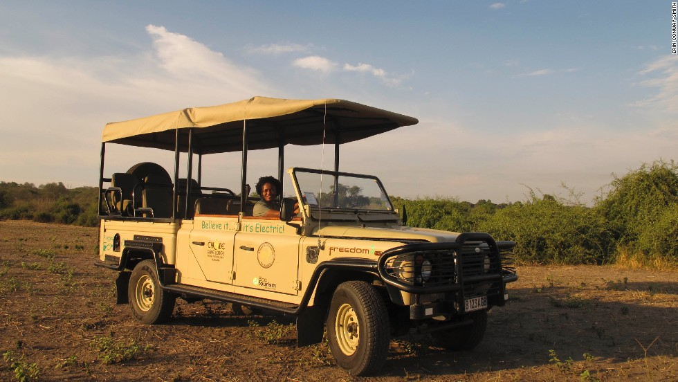 A guide behind the wheel of Chobe Game Lodge's first electric game viewing vehicle, at Chobe National Park in Botswana.