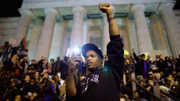 Protesters gather on the steps of the National Portrait Gallery in Washington on Tuesday, November 25. A grand jury's decision not to indict Darren Wilson, a white police officer, in the August shooting death of unarmed black teenager Michael Brown in Ferguson, Missouri, has prompted demonstrations across the country. See photos of the unrest in Ferguson.
