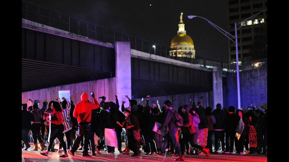 Protesters block all lanes of Interstate 75/85 northbound near the Georgia state Capitol in Atlanta on November 25.