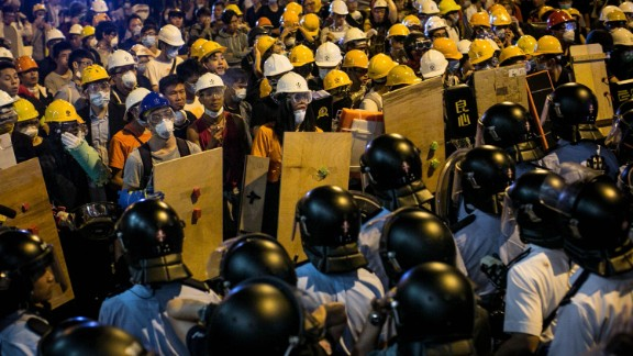 Police clash with protesters as they try to clear the streets after agents authorized by bailiffs removed barricades in Hong Kong's Mong Kok district November 26.