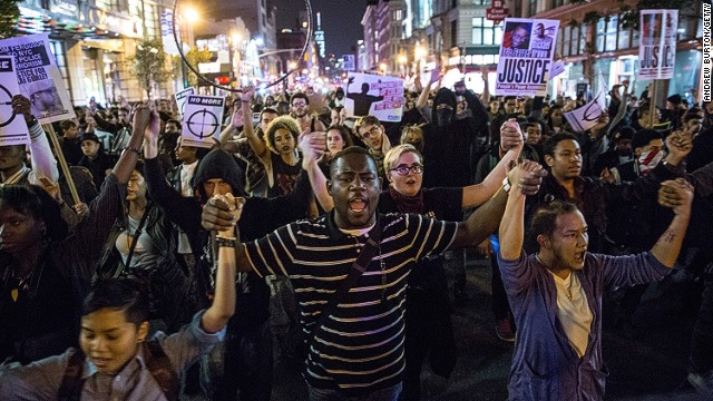 Demonstrators march through the streets of New York on November 24 to protest the decision by a Ferguson grand jury to not indict Officer Darren Wilson in the death of Michael Brown.