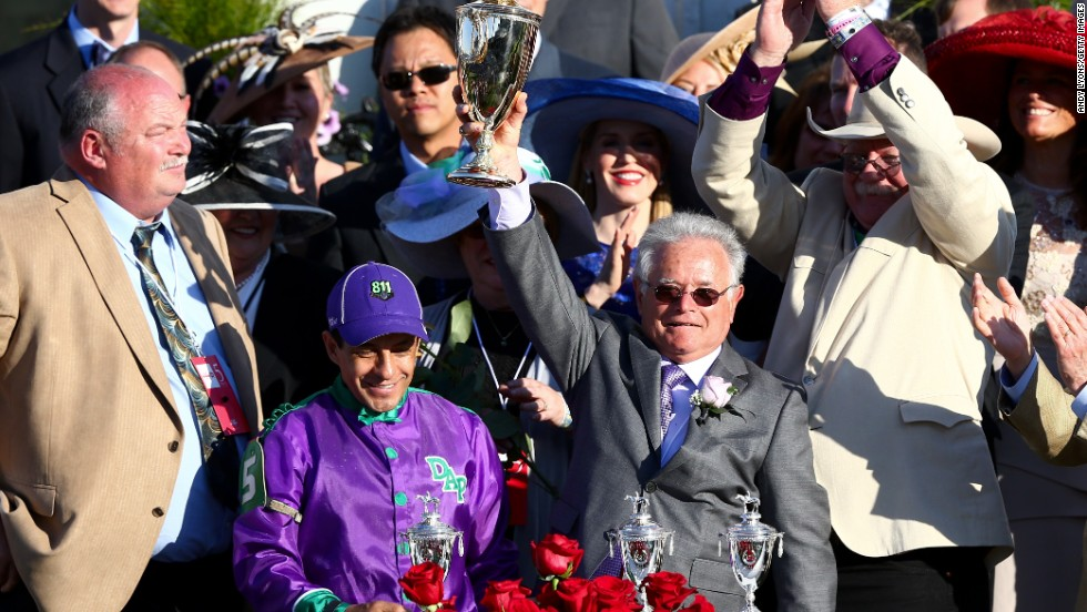 California Chrome's trainer Art Sherman (right) became the oldest trainer to win the Kentucky Derby at the age of 77.