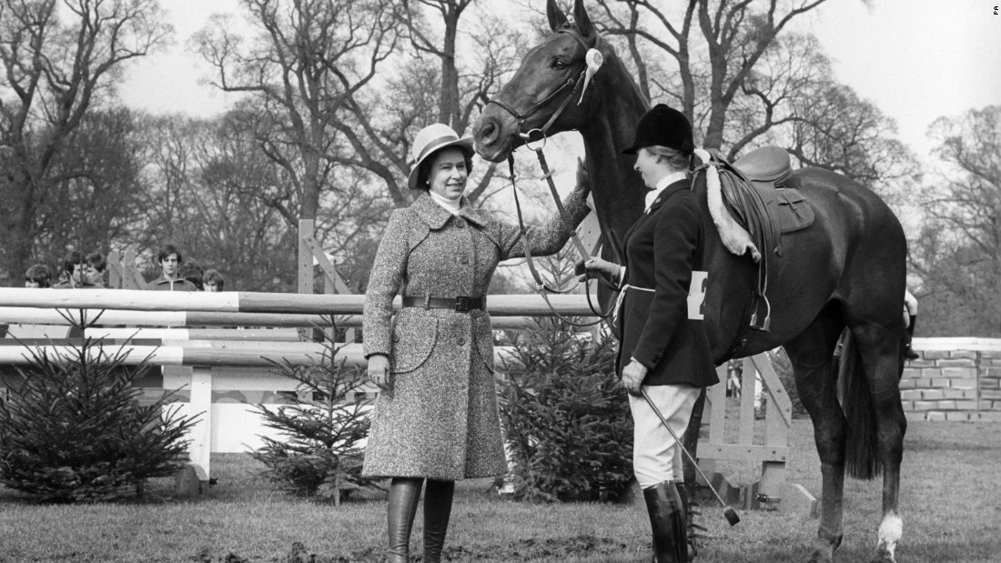 "A ""well done"" pat for Doublet as the Queen congratulates Princess Anne and her mount after they had taken fifth place in the 1975 Badminton Horse Trials."