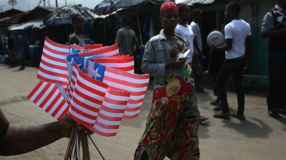A street vendor sells Liberian flags near an Ebola isolation ward on August 15, 2014 in the country