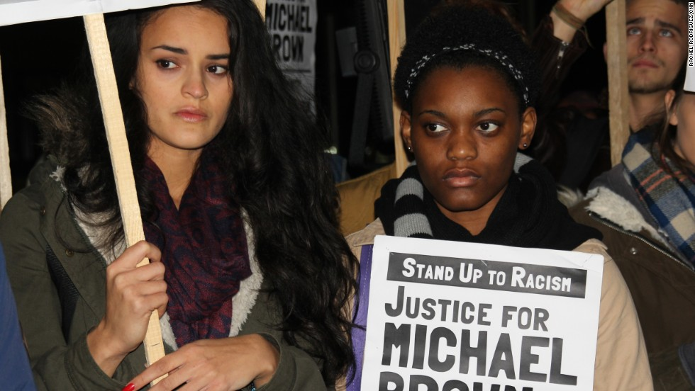 Hundreds of protesters gathered outside the U.S. Embassy in London on November 26, 2014, in solidarity with the family of Michael Brown and the people of Ferguson, Missouri.